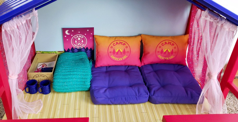 Inside of Camp American Girl Hangout with pillows and lounges