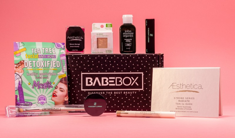 Babebox subscription box of full size beauty products on pink background