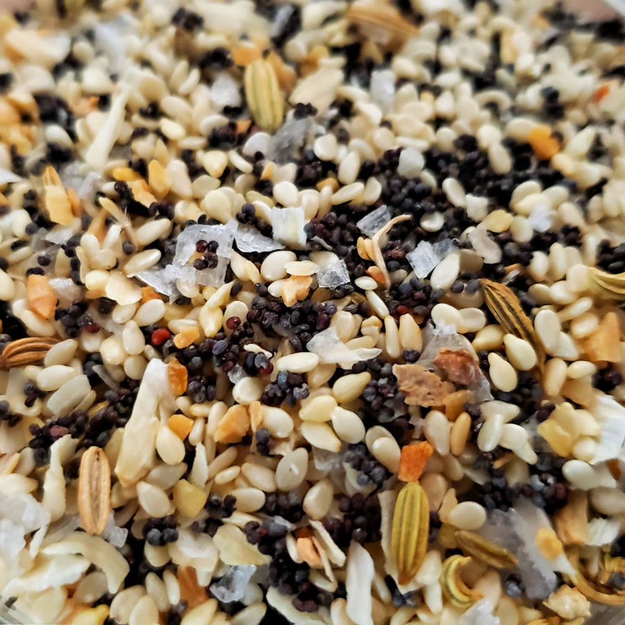 Super close up image of homemade everything bagel seasoning where you can see every grain
