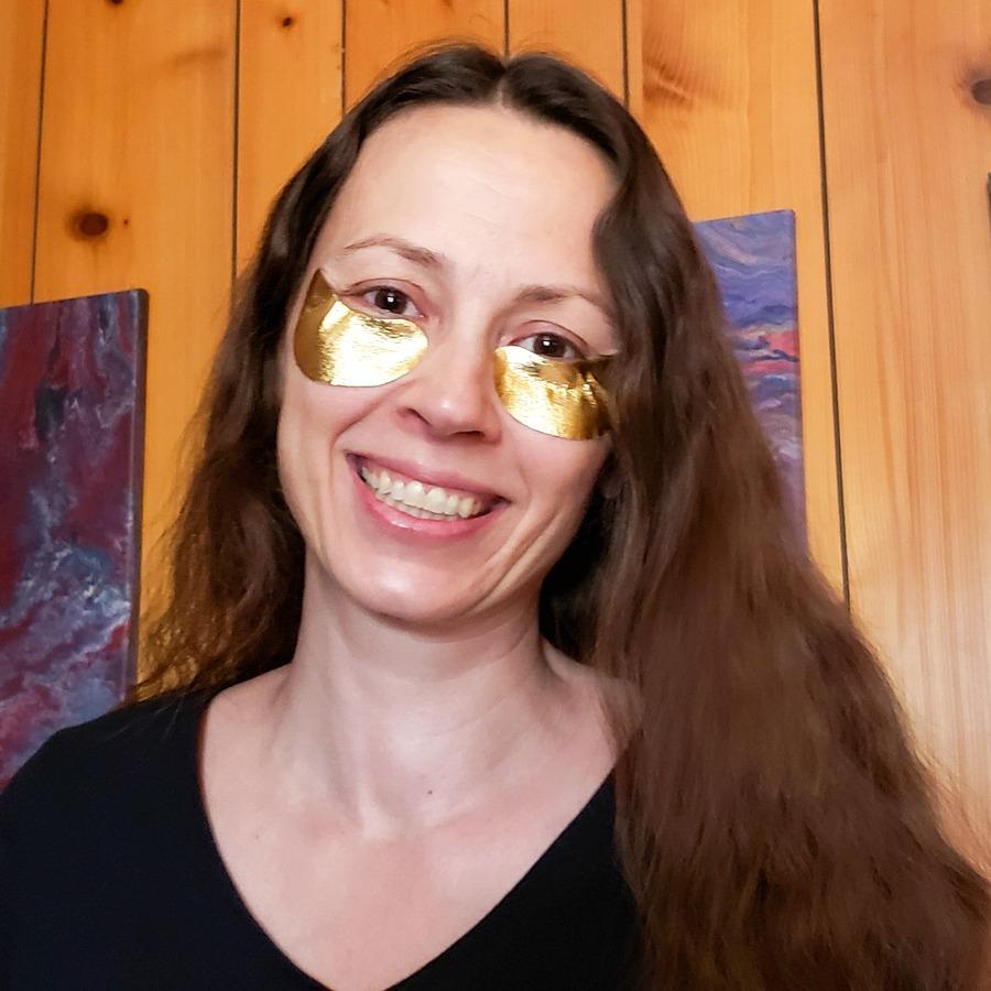 Chrystal wearing gold eye mask
