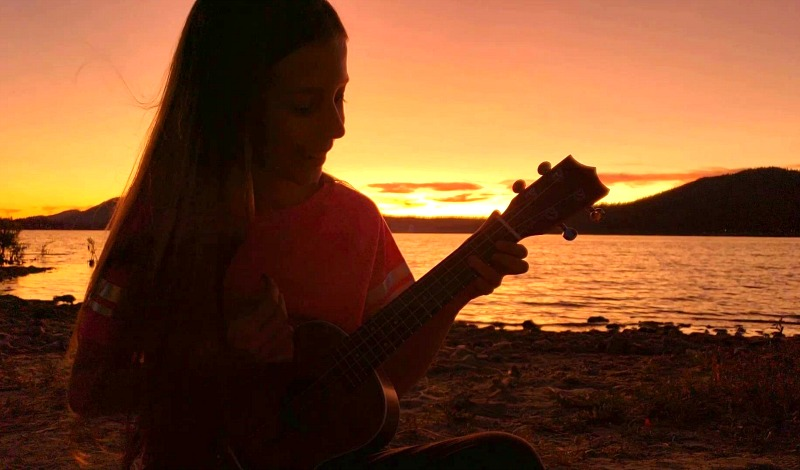 Zoë playing ukulele at sunset by Big Bear Lake