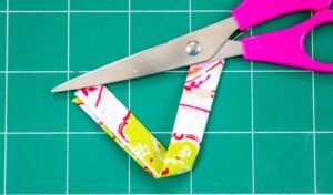 Cut fabric strip for hanging pot holder