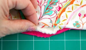 Turning the pot holder right side out so the fabric you chose is exposed