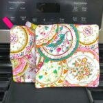 Two homemade paisley printed pot holders on an oven