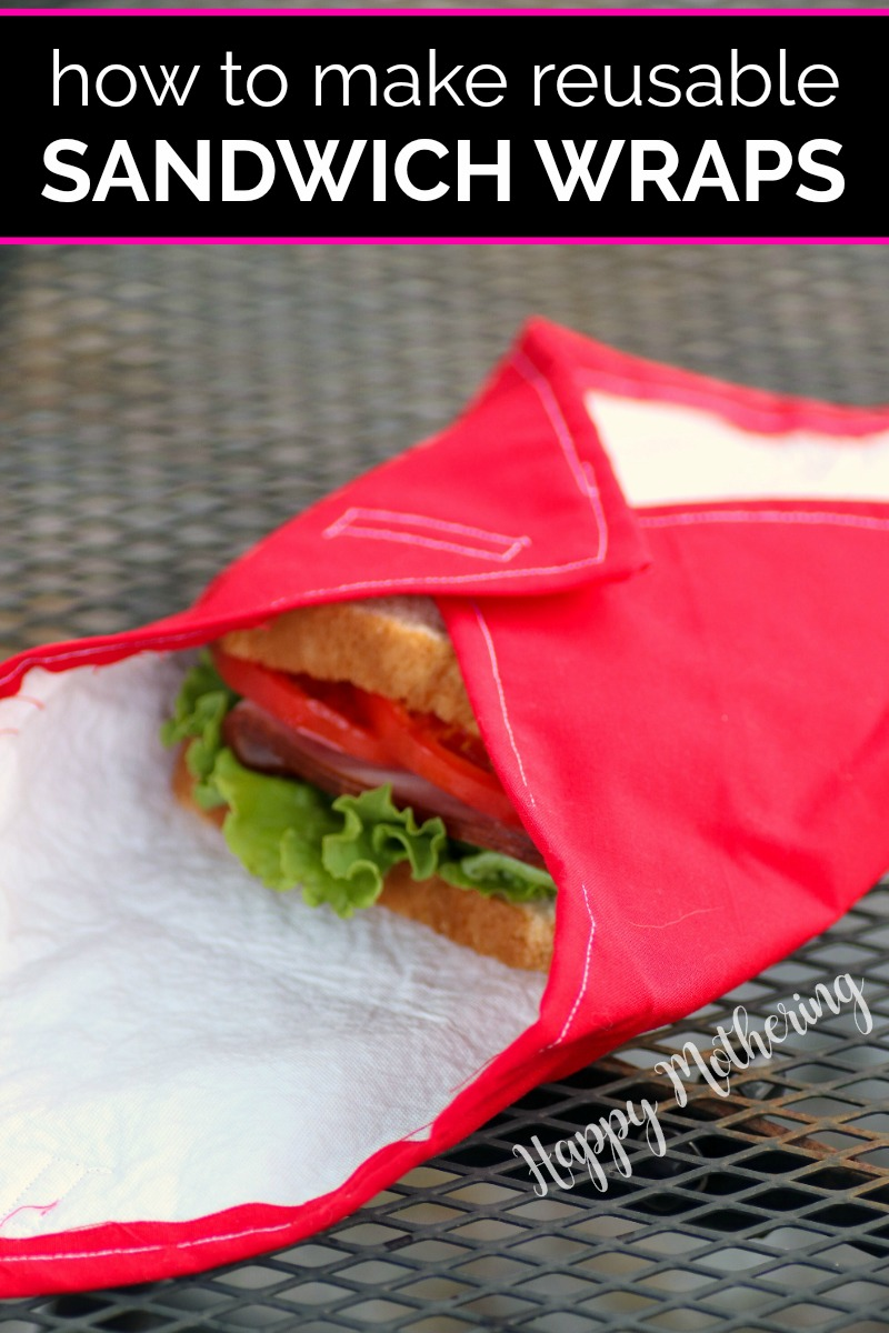 Red reusable sandwich wrap on metal table with exposed sandwich