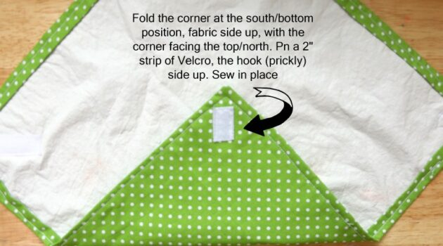 Sew a velcro strip prickly size up on the underside of the bottom corner.