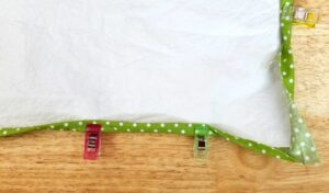 Pin the border of the cotton fabric over the waterproof fabric