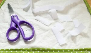 Measuring and cutting the velcro strips for the sandwich wrap closures
