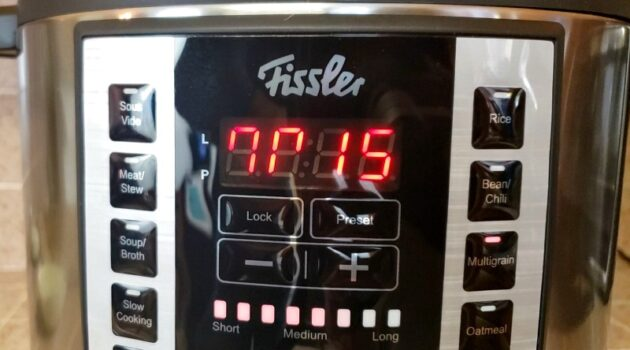 Fissler pressure cooker with time set at 15 minutes on Multigrain mode