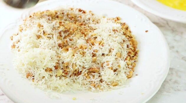 Crushed almond and grated Parmesan mixed up on a plate