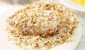 Boneless pork chop dipped in egg and coated in almond and parmesan