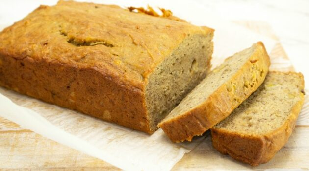 Gluten free banana bread on a cutting board with two slices