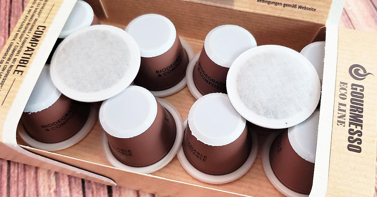 Compostable Nespresso espresso pods in a cardboard box.