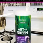An open canister of Art of Green Cleaning wipes on a white stove