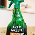 Art of Green multipurpose cleaner and green microfiber cleaning cloth on bathroom counter