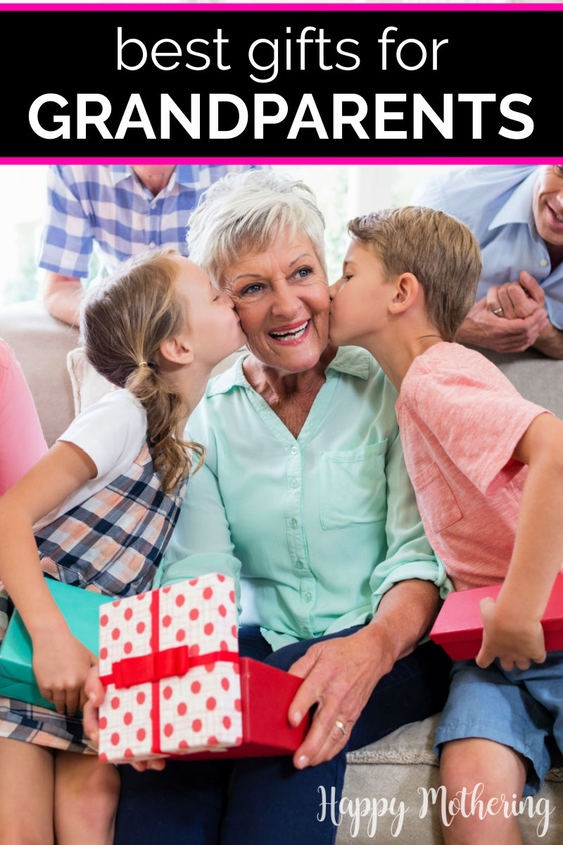 Grandma being kissed on the cheeks by grandkids who are giving her gifts