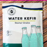 Packet of Cultures for Health Water Kefir Starter Grains laid on wood table.