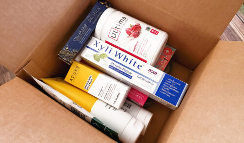 Shipping box full of products received from iHerb online shopping website.