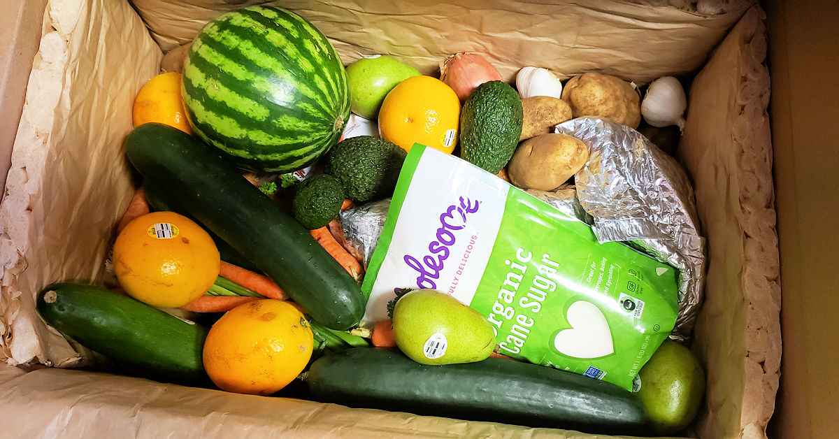 Cucumbers, watermelon, pears, lemons, sugar and more in a shipping box from Imperfect Foods.