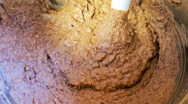 Immersion blender blending up refried beans in an Instant Pot.