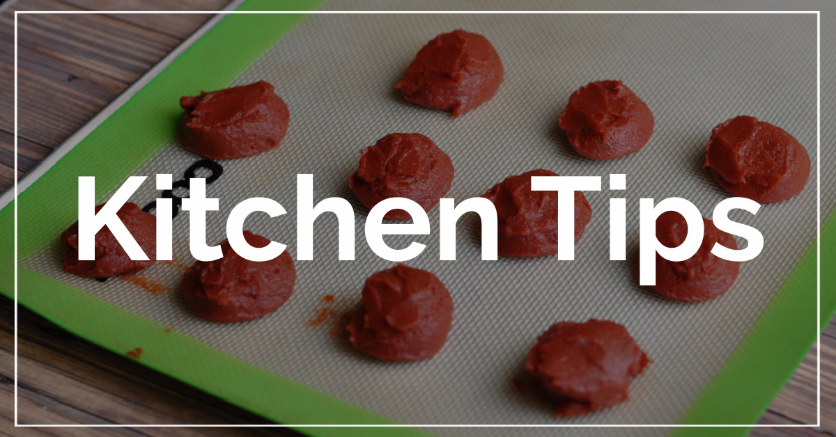 Kitchen Tips category. With a background of tablespoons of tomato paste.