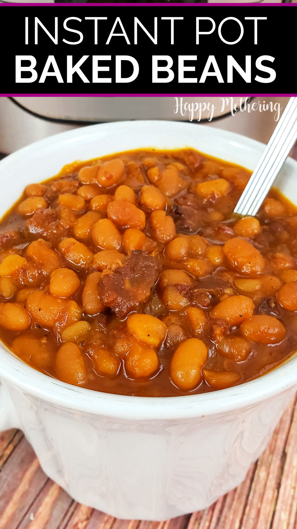 White soup bowl filled with homemade baked beans in front of Instant Pot they were cooked in.