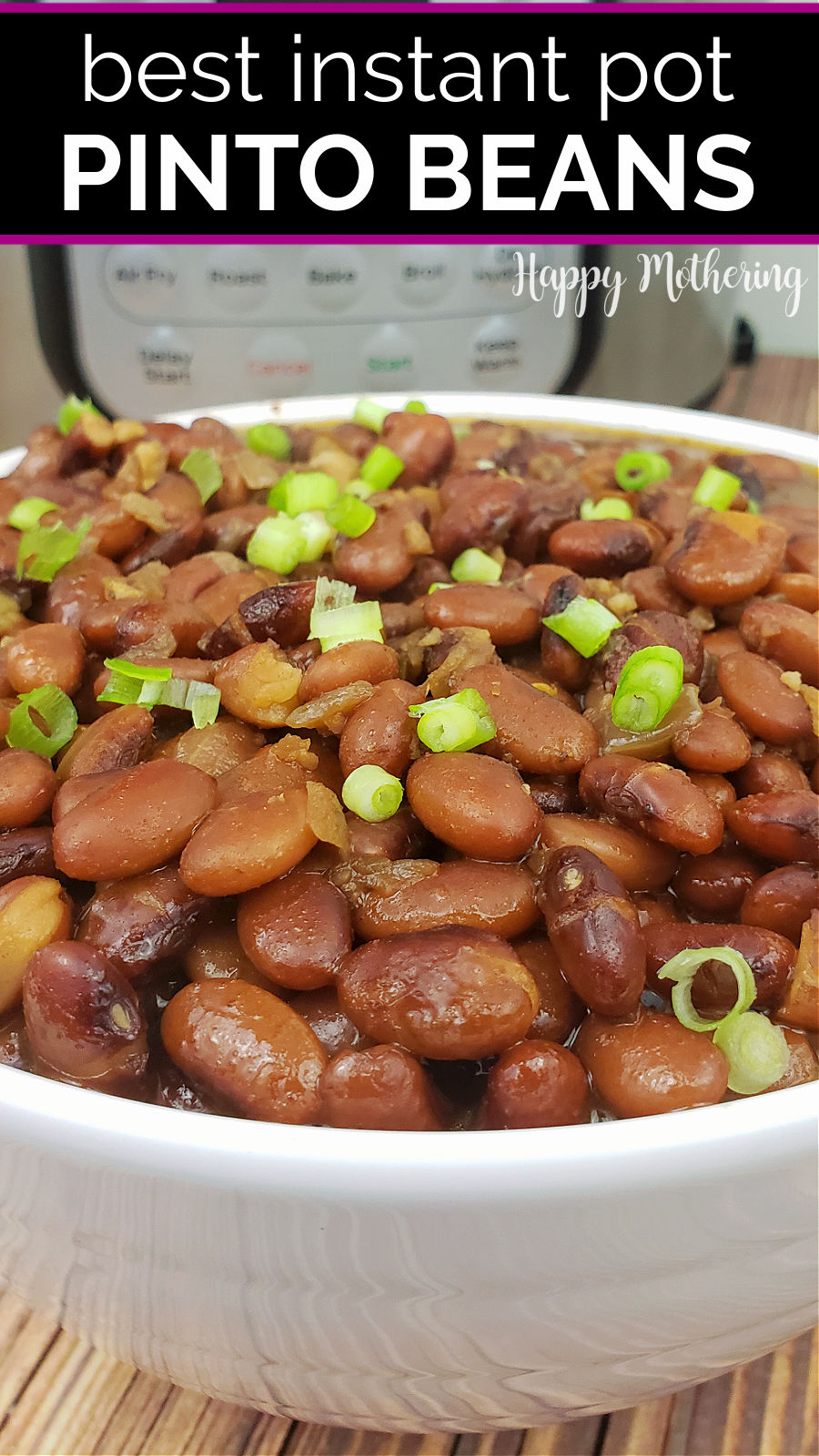 Large white serving bowl filled with cooked pinto beans in front of Instant Pot.