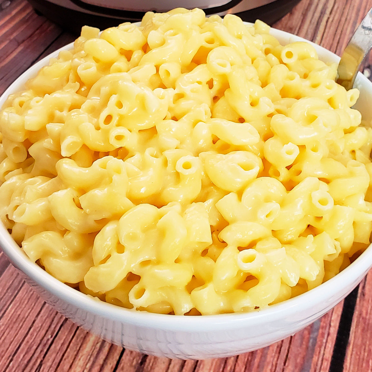 Close up of gluten free mac and cheese in white serving bowl.
