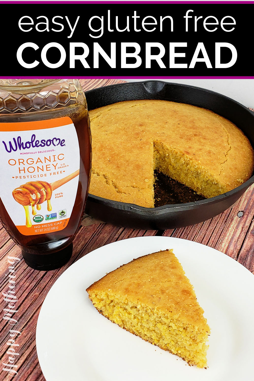 Slice of cornbread on plate in front of skillet with jar of honey.