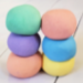 6 balls of homemade cloud dough in rainbow colors.