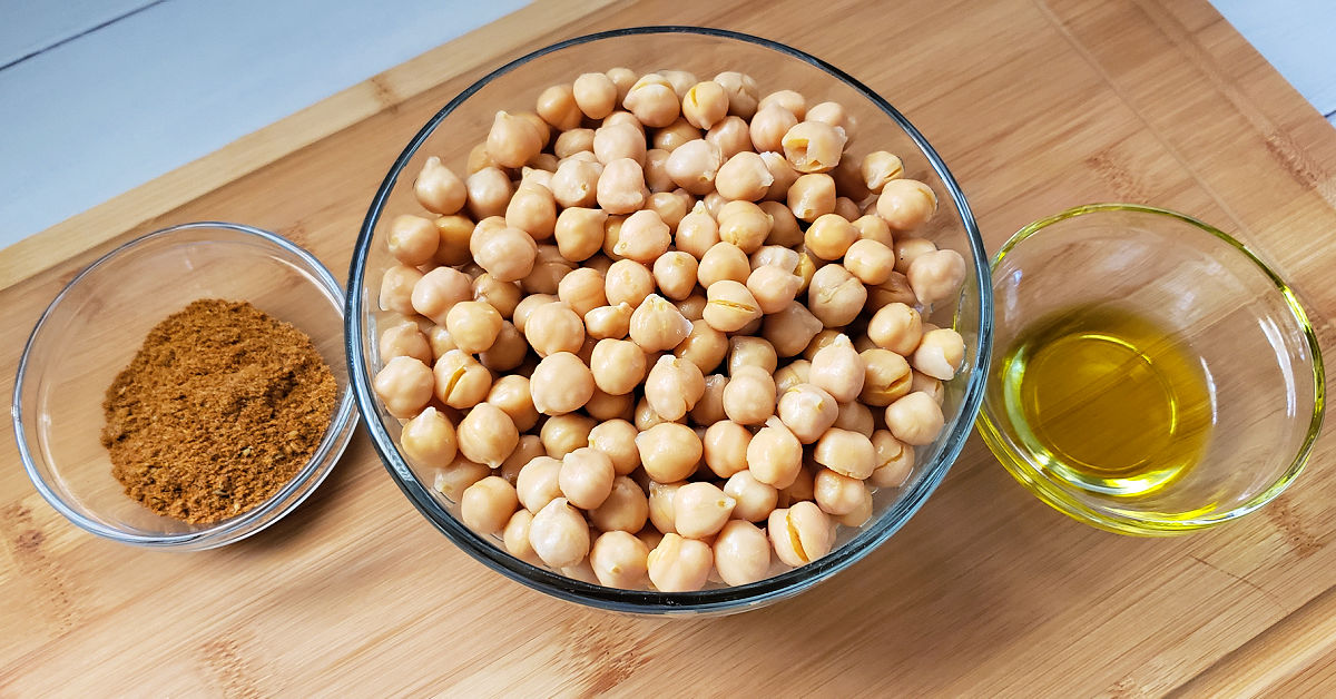 Canned garbanzo beans, extra virgin olive oil and taco seasonings in bowls.